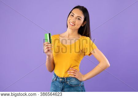 Easy Payment, Banking Concept. Portrait Of Smiling Young Female Model Holding And Showing Plastic Cr