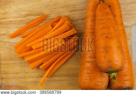 carrot raw cut into strips on a cutting board