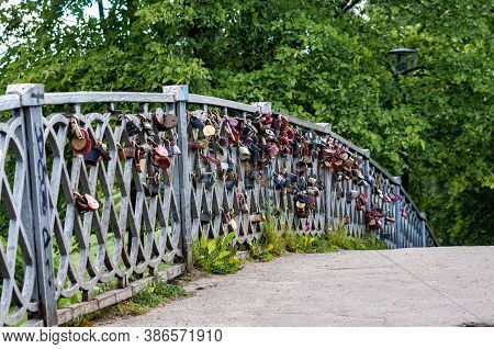 Petrozavodsk, Russia - 17 August 2020. A Bridge With Many Padlocks On The Railing