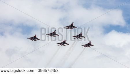 Barnaul, Russia - September 18, 2020: A Low Angle Shot Of Strizhi Mig-29 Fighter Jet Squadron Perfor