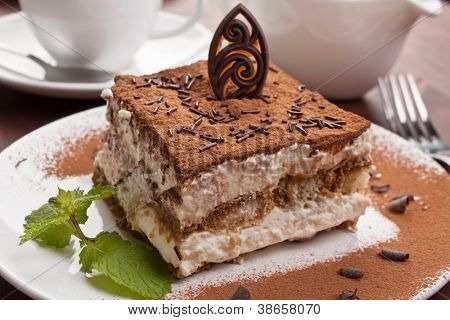 Slice of homemade italian tiramisu dessert served on a plate