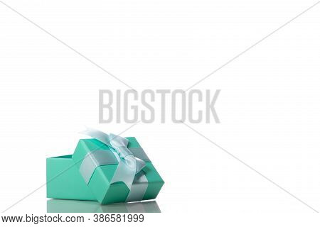 Opened Beautiful Mint Colour Gift Box With Bow Isolated On White Background. Presents, Surprise, Hol
