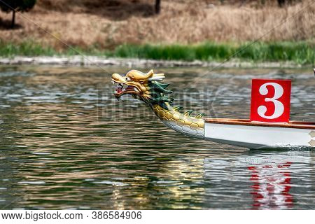 Prow Of Traditional Chinese Dragon Boat On A River