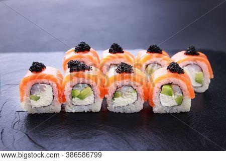 Seafood Delicatessen Salmon Sushi Rolls On Slate. Gourmet Snacks, Japanese Food, Restaurant Menu