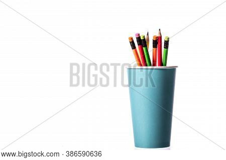 Disposable Coffee Cup As Pencil Holder. Bunch Of Multi Colored Wooden Pencils With Rubber Eraser In
