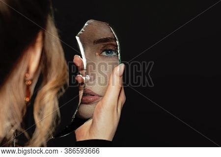 Young Perfect Woman Holding Broken Self-image Mirror On Black Background