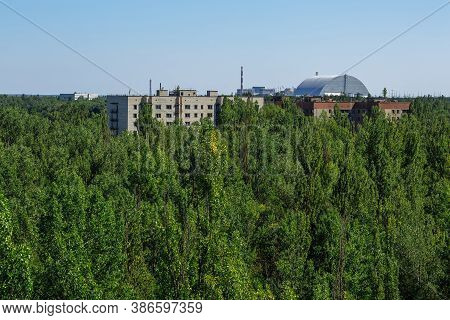 Abandoned Buildings And Sarcophagus Above The Reactor In Ghost Town Pripyat Chornobyl Zone