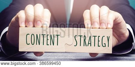 Businessman Puts Together Wooden Puzzles With The Words Content Strategy. Planning, Development, And