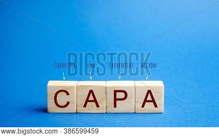 Wooden Blocks With The Word Capa. Corrective And Preventive Action Plans. Business Management Concep