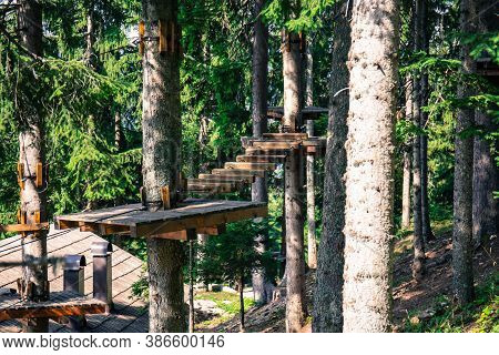 Adrenaline Park In The Woods. Climbing Trees And Walking On Heights. A Natural Environment Full Of A