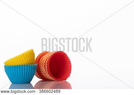 Colorful Silicone Muffin Molds Isolated On White Background. Cooking Workshop For Children, Ads, Kit