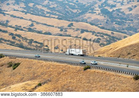 Freeway Road With Cars Crossing The The San Luis Reservoir Valleys During Dry And Hot Season, San Lu