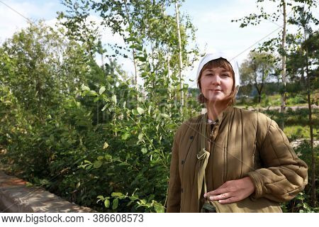 Woman In Quilted Jacket In Park