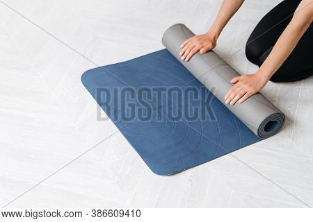 Close Up Woman Hands Preparing Fitness Equipment For Yoga Or Workout Class At Home Or In Sport Gym.