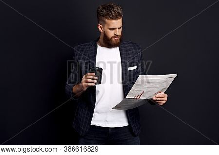 Bearded Smart Handsome Concentrated Chief Dressed In Jacket And Shirt Reading Latest News From Newsp