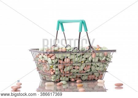 Bunch Of Various Colorful Medicine Pills In Shopping Basket Isolated On White Background. Healthcare