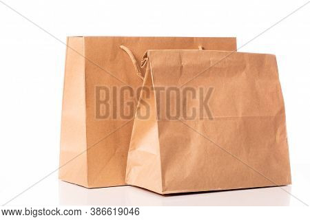 Two Disposable Biodegradable Kraft Paper Bags Isolated On White Background. Recycling And Ecology Co