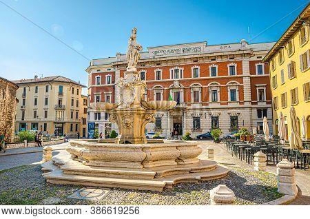 Brescia, Italy, September 11, 2019: Fountain, Street Restaurant Tables And Credito Agrario Bresciano