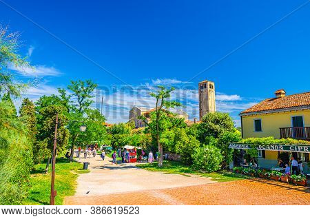 Torcello, Italy, September 14, 2019: Island With Green Trees And Bushes, Cathedral Of Santa Maria As
