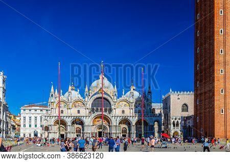 Venice, Italy, September 13, 2019: People Walking Down Piazza San Marco St Marks Square With Basilic