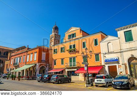 Chioggia, Italy, September 16, 2019: Clock And Bell Tower Of Cathedral Santa Maria Assunta And Row O