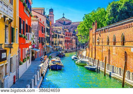 Venice Cityscape With Narrow Water Canal With Moored Boats Between Old Colorful Multicolored Buildin