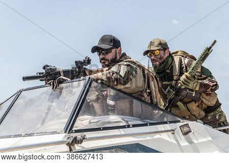 Navy Seals Team Fighters, Army Special Operations Soldiers Squad, In Combat Uniform, Armed Submachin