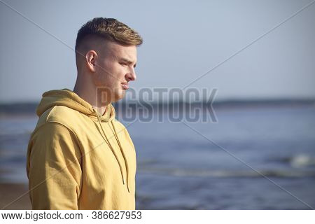 Portrait Of Young Sad Frustrated Man Suffering Because Of Heartbreak On The Beach With A Desperate L