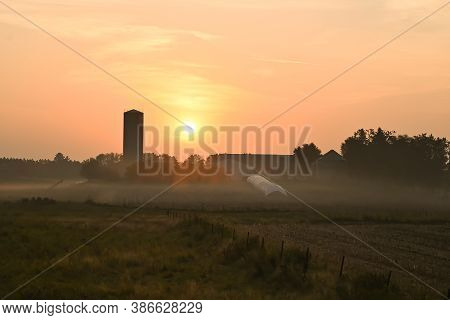 Foley, Mn/usa - September 23, 2020. Sunrise Over A Minnesota Farm With A Barn And Silo.