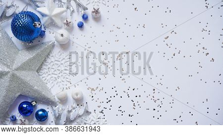 Christmas And New Year White Stars,snowflakes And Blue Christmas Balls And Decorations Among Sparkle
