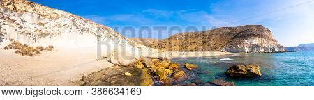 Panoramic View Of The Gigantic White Rock Walls In Cala De Enmedio And The Sea In The Natural Park O