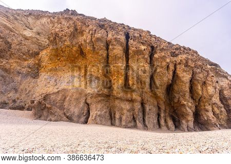 Natural Walls Of The Playa De Los Muertos In The Natural Park Of Cabo De Gata, Nijar, Andalucia. Spa