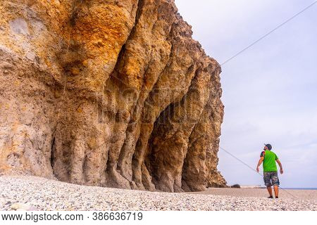 A Young Man With Open Arms In The Beautiful Natural Walls Of Playa De Los Muertos In The Natural Par