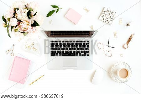 Flat Lay Womens Office Desk. Female Workspace With Laptop, Pink Peonies Bouquet, Accessories On Whit