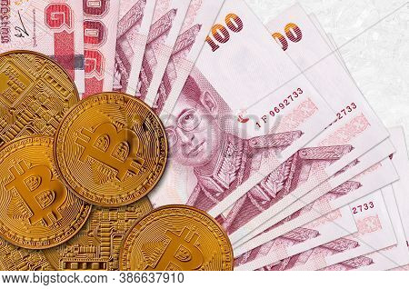 100 Thai Baht Bills And Golden Bitcoins. Cryptocurrency Investment Concept. Crypto Mining Or Trading