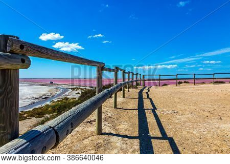 Observation deck. Pink Salt Water Estuary. Salt production on the seashore. The Mediterranean coast of France, the area of Camargue. The nature reserve includes saltwater and dunes