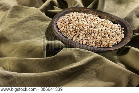 Uncooked Dried Lentils In A Wooden Bowl - Lens Culinaris
