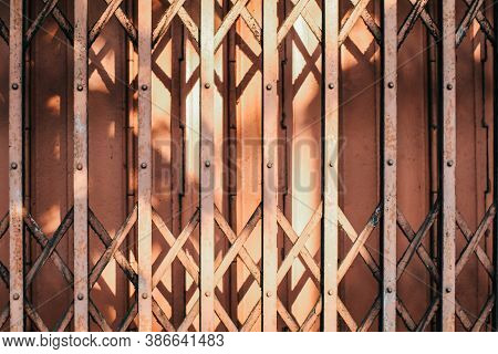 Morning Sunlight And Shadow On The Closed Metal Steel Door - Folding Door Texture Pattern And Backgr