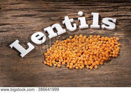 Uncooked Red Lentils On Rustic Wooden Background - Lens Culinaris
