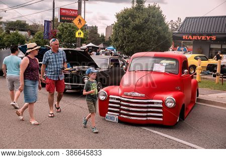 Toronto, Canada - 08 18 2018: Visitors Of The Open Air Auto Show Wheels On The Danforth Beside Gorge