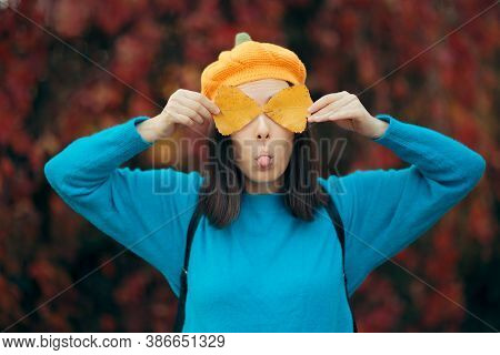 Hilarious Girl With Tongue Out Holding Autumn Leaves
