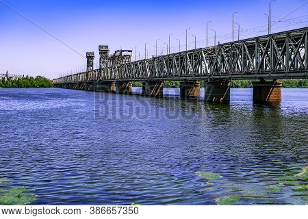 Side View Of The Amur Bridge In Dnepropetrovsk (ukraine). Old Stone And Metal Bridge Over The Dniepe