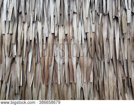 Thatch Roof Or Wall Background, Hay Or Dry Grass Background. A Thatched Roof Or Wall, Hay Or Dry Gra