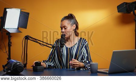 Influencer Talking About New Camera Lens In Her Weekly Podcast Review Episodes. Content Creator New