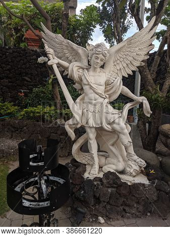 Denpasar, Indonesia - September 28, 2019: Angel Statue On The Park Of Holy Spirit Cathedral.