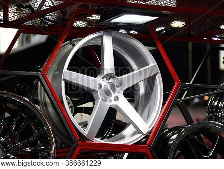Alloy Wheel Of Car On The Shelf With Red Hexagon Frame. Alloy Wheels Are Wheels That Are Made From A