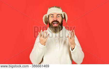 Winter Holidays. Male Winter Style. Modern Winter Earflap Beanie Hat. Funky Happy Bearded Man. Matur