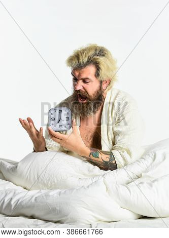 Awakening. Stressed Man Alarm Clock. Sleepy Guy And Alarm Clock In Bed. Bearded Man With Alarm Clock