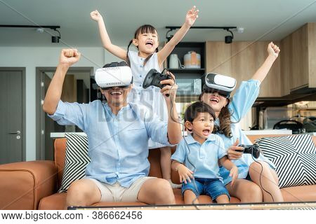 Happy Asian Family At Home On Living Room Sofa Having Fun While They Are Looking Mother And Father P