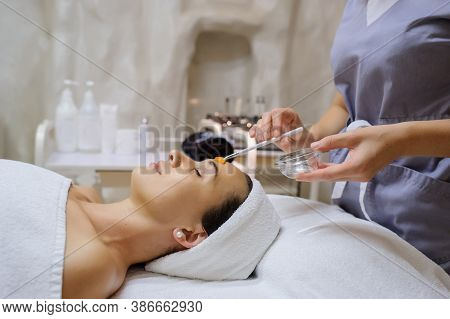 Lateral View Of Woman Facial Massage Spa Procedure. Electric Stimulation Facial Skin Care. Microcurr